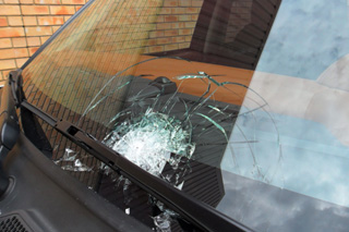 Damaged bullet-resistant windscreen on armoured vehicle