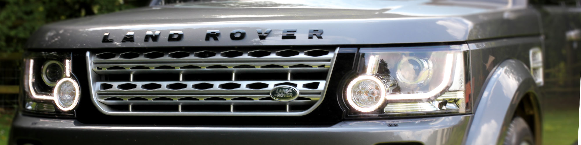 Close-up view of front of armoured Land Rover Discovery