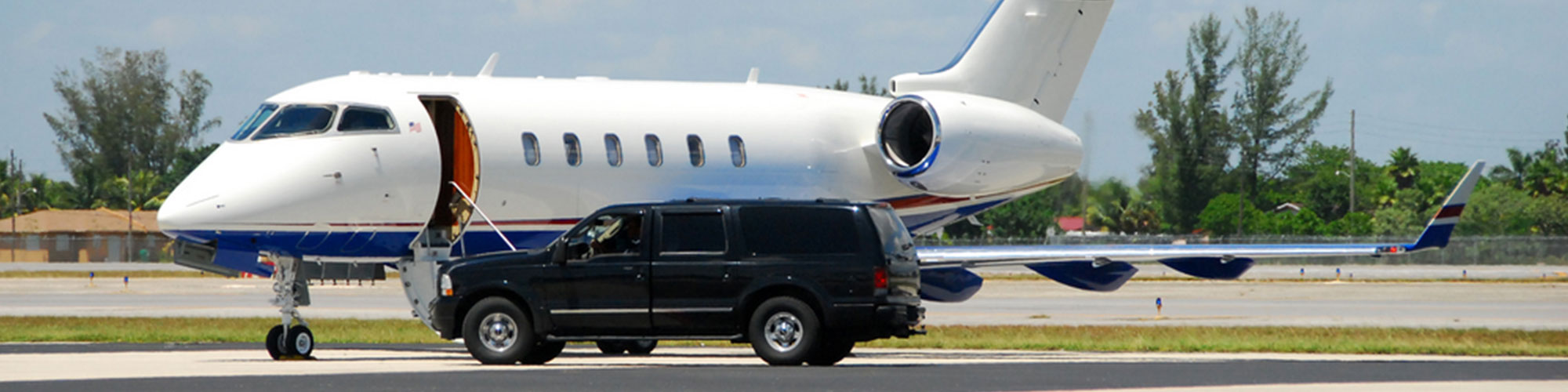 Armoured SUV waiting beside private jet at airport for VIP