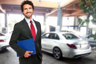 Sales agent smiling with order form